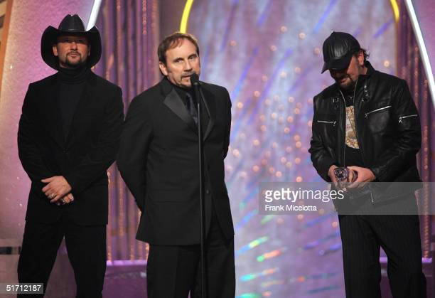 Producers Byron Gallimore and Darren Smith with singer Tim McGraw accepts their award for Best Single of the Year on stage at the 38th Annual CMA...