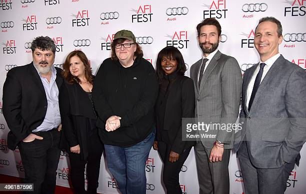Producers Carl Deal and Tia Lessin filmmaker Michael Moore AFI FEST Director Jacqueline Lyanga and Jason Janego and Tom Quinn attend the Centerpiece...