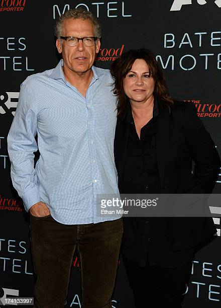 Producers Carlton Cuse and Kerry Ehrin attend AE's Bates Motel party during ComicCon International 2013 at Gang Kitchen on July 20 2013 in San Diego...