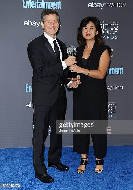Producers Clay Newbill and Yun Lingner poses in the press room at the 22nd annual Critics' Choice Awards at Barker Hangar on December 11 2016 in...