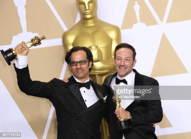 Producers Dan Cogan and director Bryan Fogel winners of the Best Documentary Feature award for 'Icarus' pose in the press room at the 90th Annual...