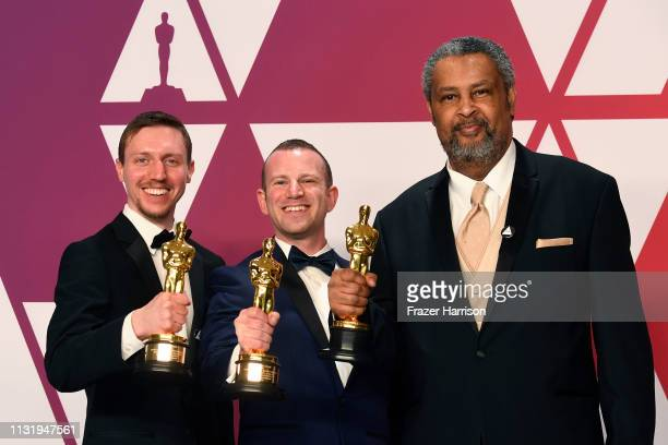 Producers David Rabinowitz Charlie Wachtel and Kevin Willmott pose with the Best Adapted Screenplay award for BlacKkKlansman in the press room during...