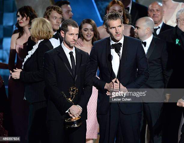 Producers DB Weiss and David Benioff and cast and crew of 'Game of Thrones' accept an award onstage during the 67th Annual Primetime Emmy Awards at...