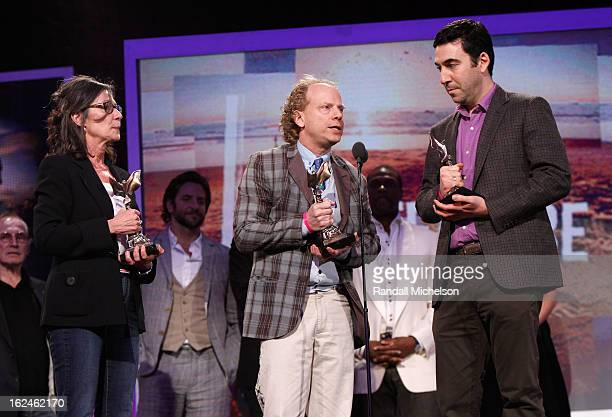Producers Donna Gigliotti Bruce Cohen and Jonathan Gordon speak onstage during the 2013 Film Independent Spirit Awards at Santa Monica Beach on...