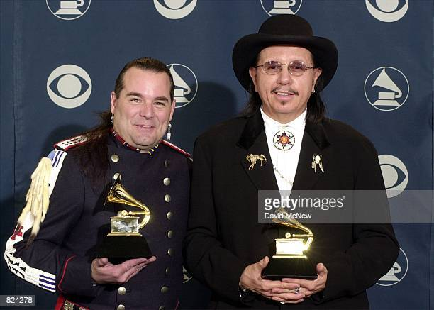 Producers Douglas Spotted Eagle and Tom Bee pose backstage with their awards at the 43rd Annual Grammy Awards February 21 2001 in Los Angeles CA They...