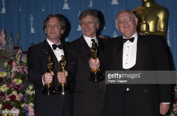 Producers Douglas Wick David Franzoni and Branko Lustig with their Oscars for Best Picture of the Year Gladiator at the 73rd Academy Awards