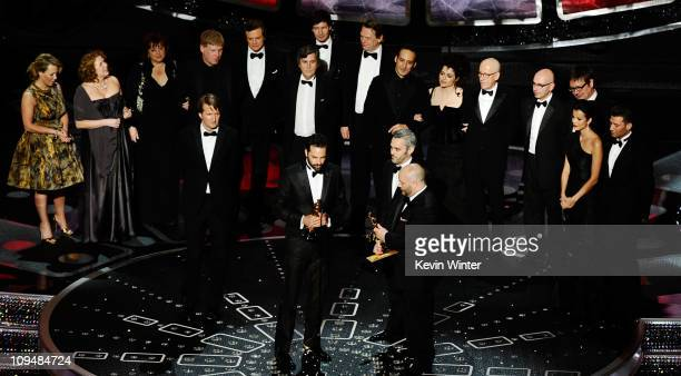 Producers Emile Sherman Iain Canning and Gareth Unwin accept the award for Best Motion Picture of the Year for 'The King's Speech' onstage during the...