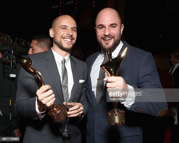 Producers Fred Berger and Jordan Horowitz pose with the International Award for Best Film for 'La La Land' during The 6th AACTA International Awards...