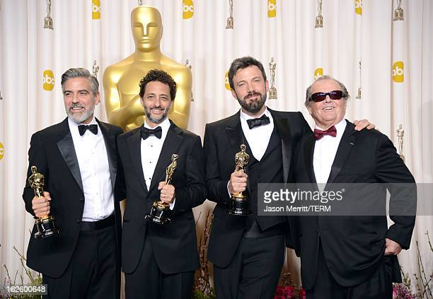 Producers George Clooney and Grant Heslov and actorproducerdirector Ben Affleck winners of the Best Picture award for Argo with presenter Jack...