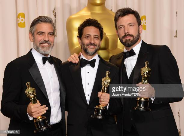 Producers George Clooney and Grant Heslov and actorproducerdirector Ben Affleck winners of the Best Picture award for Argo pose in the press room...