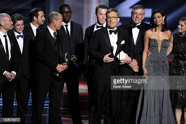 Producers Gideon Raff Howard Gordon and Alex Gansa and actress Morena Baccarin accept Outstanding Drama Series award for Homeland onstage during the...