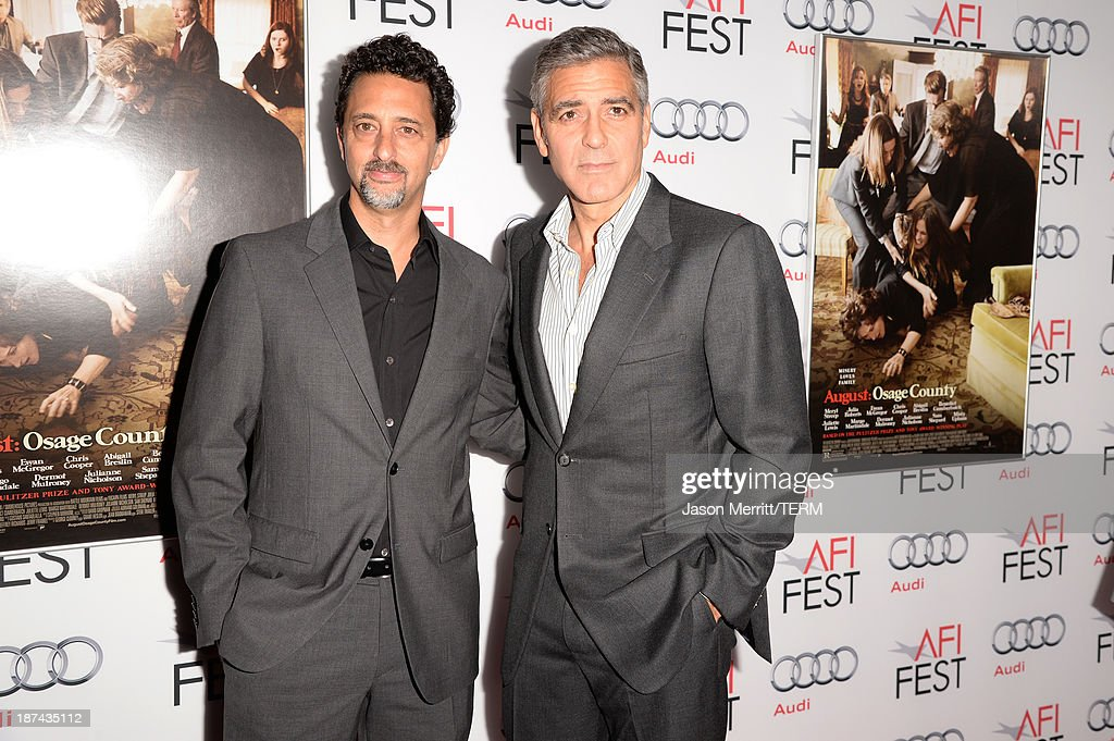 Producers Grant Heslov and George Clooney attend the premiere of The Weinstein Company's 'August: Osage County' during AFI FEST 2013 presented by Audi at TCL Chinese Theatre on November 8, 2013 in Hollywood, California.
