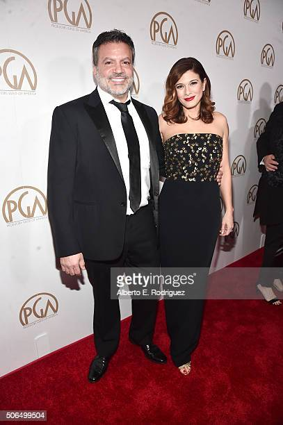 Producers Guild Of America coChair Michael De Luca and actress Angelique Madrid attend the 27th Annual Producers Guild Of America Awards at the Hyatt...