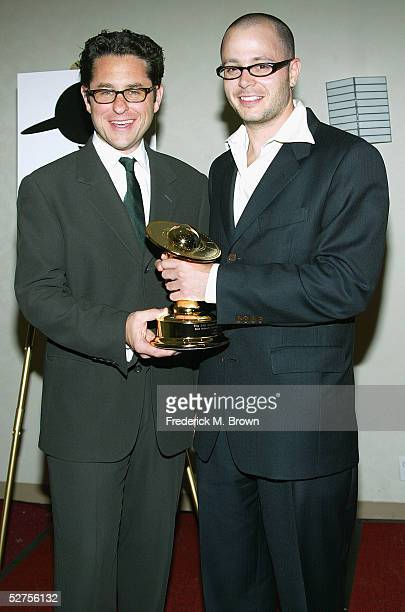 Producers J J Abrams and Damon Lindelof pose with the trophy after being honored during the 31st Annual Saturn Awards at the Universal Hilton Hotel...