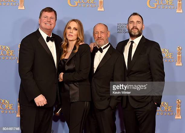 Producers James W Skotchdopole Mary Parent Steve Golin and Keith Redmon winners of Best Motion Picture Drama for Motion Picture for The Revenant pose...