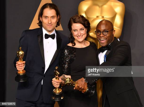 Producers Jeremy Kleiner Adele Romanski and director Barry Jenkins winners of the Best Picture award for Moonlight pose in the press room during the...