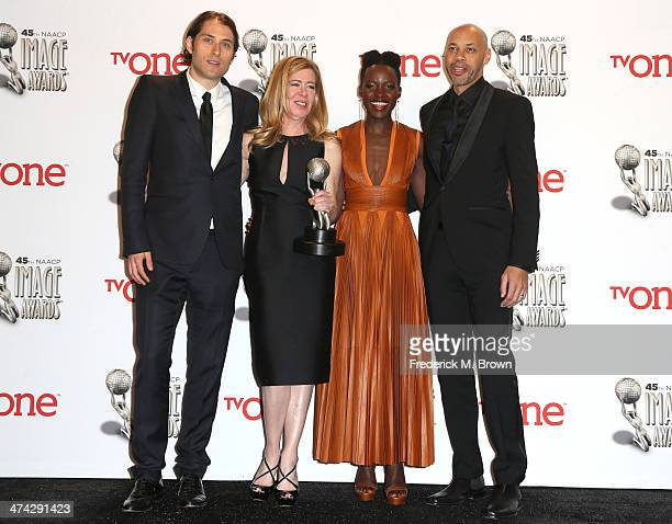 Producers Jeremy Kleiner and Dede Gardner actress Lupita Nyong'o and screenwriter John Ridley winners of the Outstanding Motion Picture award for '12...