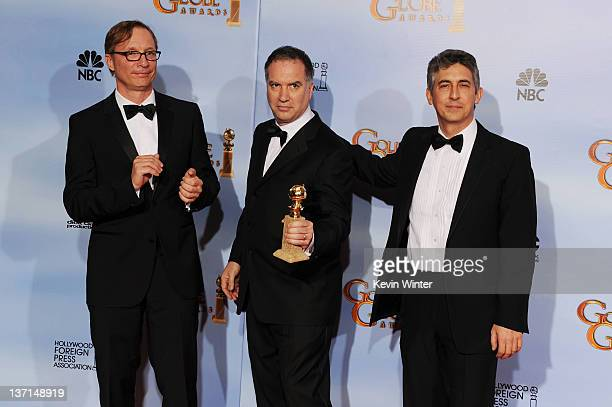 Producers Jim Burke Jim Taylor and director/producer Alexander Payne pose in the press room at the 69th Annual Golden Globe Awards held at the...