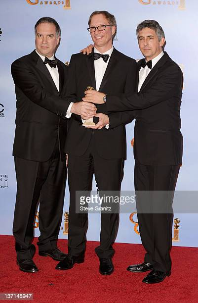 Producers Jim Taylor and Jim Burke and writerdirectorproducer Alexander Payne pose in the press room at the 69th Annual Golden Globe Awards held at...