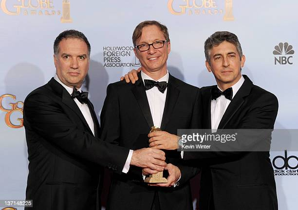 Producers Jim Taylor Jim Burke and director/producer Alexander Payne pose in the press room at the 69th Annual Golden Globe Awards held at the...