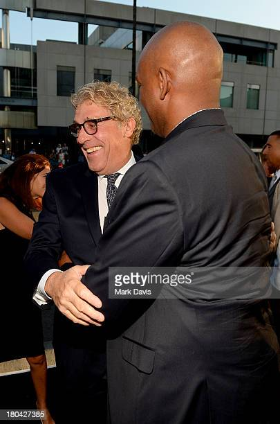 Producers John H Starke and Broderick Johnson attend the Warner Bros Pictures' premiere of Prisoners at the Academy of Motion Picture Arts and...
