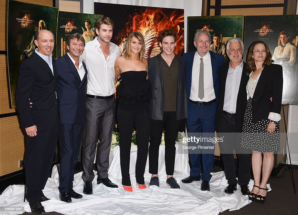 Producers Jon Kilik, Patrick Wachsberger, Actors Liam Hemsworth, Jennifer Lawrence, Sam Claflin, director Francis Lawrence, producer Patrick Wachsberger and Nina Jacobson attend the photocall for 'The Hunger Games: Catching Fire' at The 66th Annual Cannes Film Festival at Majestic Hotel on May 18, 2013 in Cannes, France.