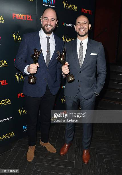 Producers Jordan Horowitz and Fred Berger pose with the International Award for Best Film during The 6th AACTA International Awards on January 6 2017...
