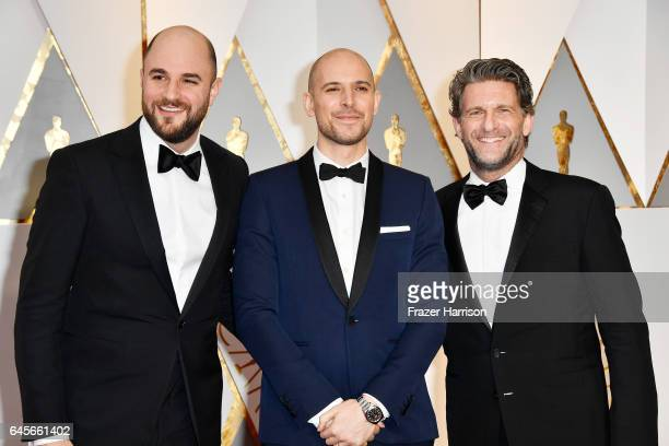 Producers Jordan Horowitz Fred Berger and Gary Gilbert attend the 89th Annual Academy Awards at Hollywood Highland Center on February 26 2017 in...