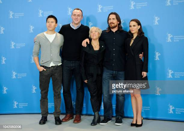 Producers Ken Kao Nicolas Gonda and Sarah Green pose with British actor Christian Bale and US actor Natalie Portman at a photo shoot for 'Knight of...