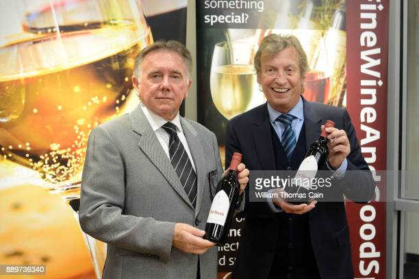 Producers Ken Warwick and Nigel Lythgoe celebrate their wine 'Fat Monk' at the grand opening of the Pennsylvania Liquor Control Board's newest Fine...