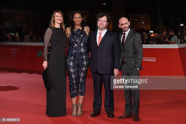 Producers Lauren Beck Kimberly Steward director Kenneth Lonergan and producer Josh Godfrey walk a red carpet for 'Manchester By The Sea' during the...