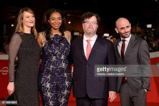 Producers Lauren Beck, Kimberly Steward, director Kenneth Lonergan and producer Josh Godfrey walk a red carpet for 'Manchester By The Sea' during the...
