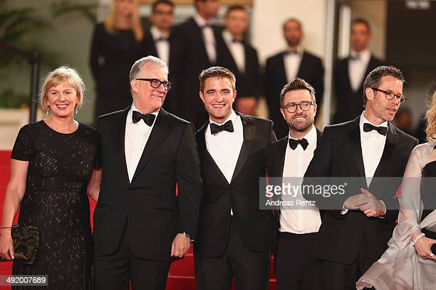 Producers Liz Watts David Linde actor Robert Pattinson director David Michod and actor Guy Pierce attend 'The Rover' premiere during the 67th Annual...