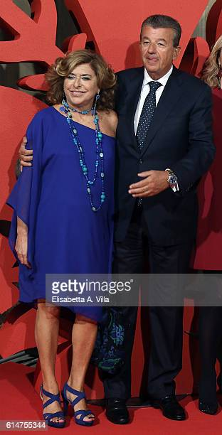 Producers Matilde Bernabei and Tarak Ben Ammar walk a red carpet for 'I Medici' at Palazzo Vecchio on October 14 2016 in Florence Italy