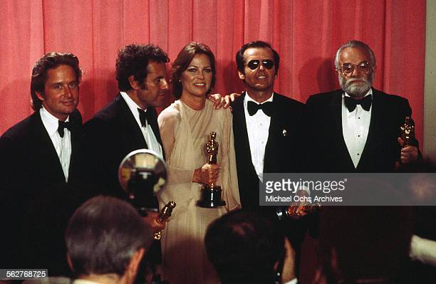 Producers Michael Douglas Saul Zaentz Director Milos Forman with Actor Jack Nicholson with actress Louise Fletcher pose backstage after winning Best...