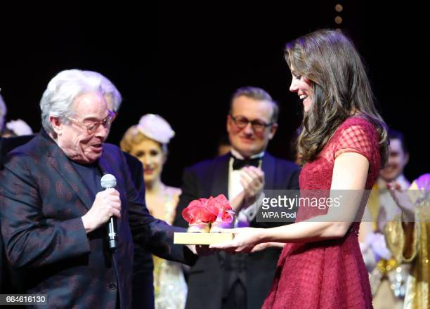 Producers Michael Grade and Michael Linnet present Catherine Duchess of Cambridge with a set of tap shoes during the Opening Night Royal Gala...