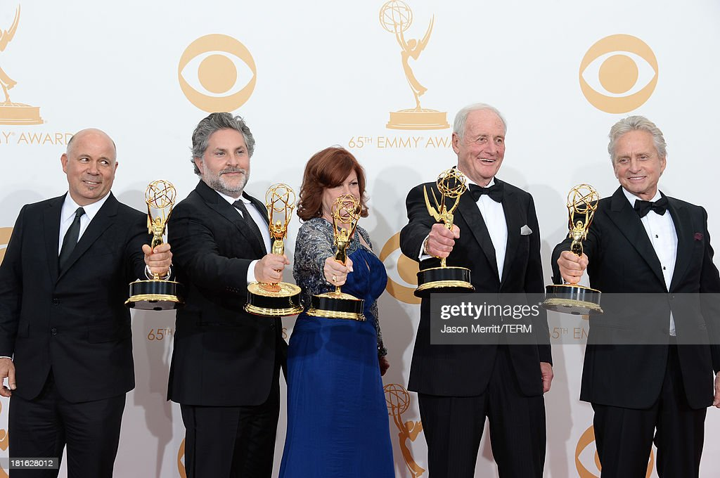 Producers Michael Polaire, Gregory Jacobs, Susan Ekins and Jerry Weintraub, winners of Outstanding Miniseries or Movie for 'Behind the Candelabra,' and actor Michael Douglas, winner of Outstanding Lead Actor in a Miniseries or Movie for 'Behind the Candelabra,' pose in the press room during the 65th Annual Primetime Emmy Awards held at Nokia Theatre L.A. Live on September 22, 2013 in Los Angeles, California.