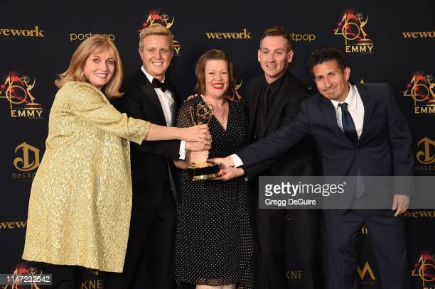 Producers of Family Feud pose with the Daytime Emmy Award for Outstanding Game Show in the press room during the 46th annual Daytime Emmy Awards at...