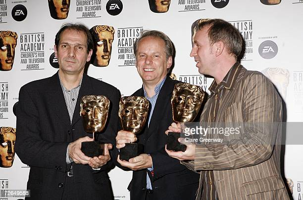 Producers Peter Lord Nick Park and Steve Box pose with the Feature Film award for Wallace and Gromit The Curse of Were Rabbit at the 11th British...