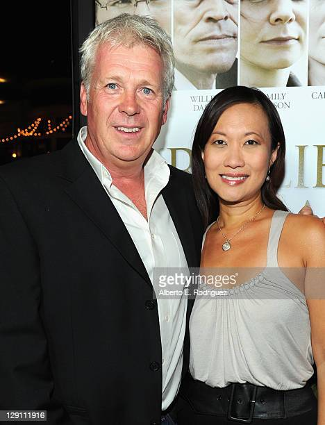 Producers Philip Rose and Sukee Chew arrive at the Fireflies In The Garden Premiere at Pacific Theaters at the Grove on October 12 2011 in Los...