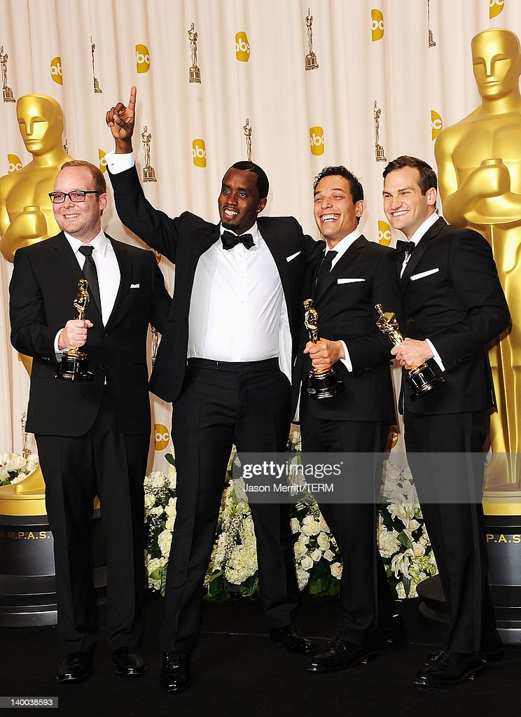 Producers Rich Middlemas, Sean Combs, TJ Martin and Dan Lindsay, winners of the Documentary Feature Award for 'Undefeated,' pose in the press room at the 84th Annual Academy Awards held at the Hollywood & Highland Center on February 26, 2012 in Hollywood, California.
