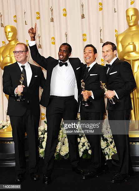 Producers Rich Middlemas, Sean Combs, TJ Martin and Dan Lindsay, winners of the Documentary Feature Award for 'Undefeated,' pose in the press room at...
