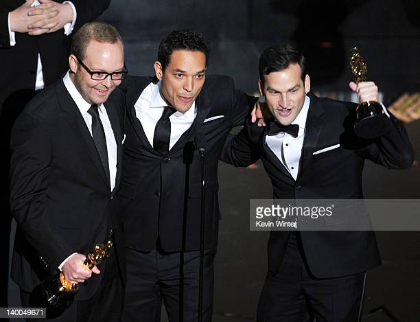 Producers Rich Middlemas, TJ Martin and Dan Lindsay, accept the Best Documentary Feature Award for 'Undefeated,' onstage during the 84th Annual...