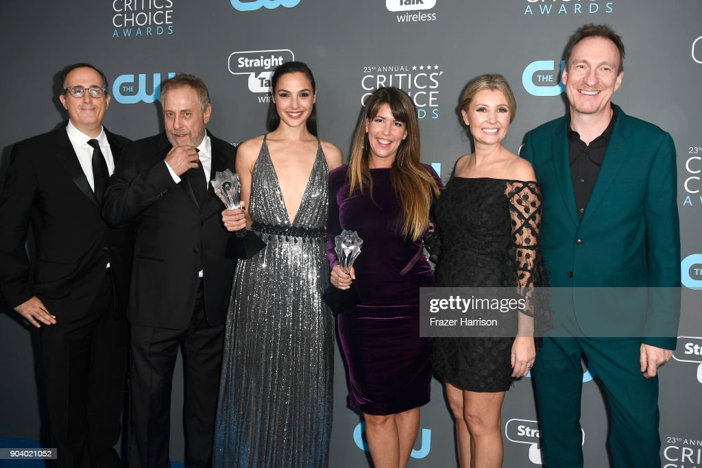 Producers Richard Suckle and Charles Roven, actor Gal Gadot, director Patty Jenkins, Connie Nielsen and David Thewlis, recipients of the Best Action Movie award for 'Wonder Woman', pose in the press room during The 23rd Annual Critics' Choice Awards at Barker Hangar on January 11, 2018 in Santa Monica, California.