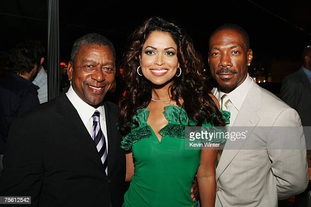 """Producers Robert Johnson , Tracey Edmonds and actor Eddie Murphy pose at the afterparty for the premiere of The Weinstein Co.'s """"Who's Your Caddy"""" at..."""