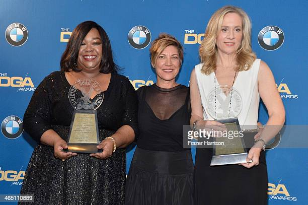 Producers Shonda Rhimes and Betsy Beers recipients of the Diversity Award poses with presenter Allison LiddiBrown in the press room during the 66th...