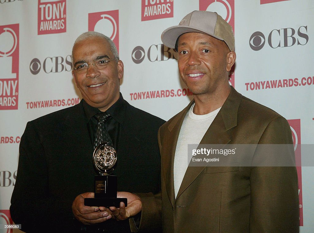 Producers Stan Lathan (L) and Russell Simmons pose backstage after winning the 'Special Theatrical Event' award for 'Russell Simmons' Def Poetry Jam' at the '57th Annual Tony Awards' at Radio City Music Hall on June 8, 2003 in New York City. The Tony Awards are presented by the League of American Theatres and Producers and the American Theatre Wing.