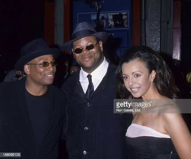 Producers Terrence Lewis and Jimmy Jam and wife Lisa Padilla attend 'How Stella Got Her Groove Back' on August 3 1998 at Mann Chinese Theater in...