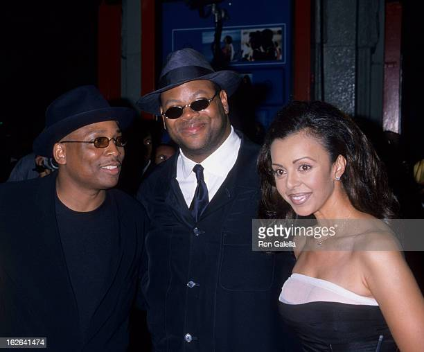 "Producers Terrence Lewis and Jimmy Jam and wife Lisa Padilla attend ""How Stella Got Her Groove Back"" on August 3, 1998 at Mann Chinese Theater in..."