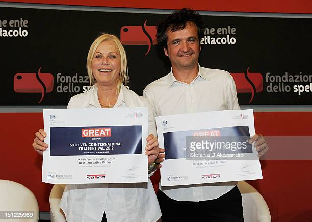 Producers Tiziana Soudani and Carlo CrestoDina pose with the UKItaly Creative Industries Award during the 69th Venice Film Festival on September 4...
